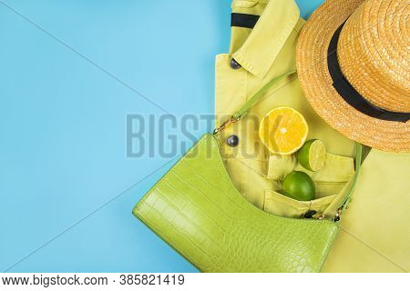 Bright Summer Citrus Flatlay With Lemons And Limes In The Green Baguette Bag, Yellow Denim Jacket An