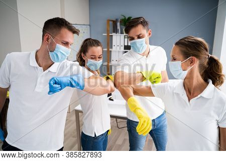 Professional Office Cleaning Janitor Team Spirit And Huddle With Face Masks