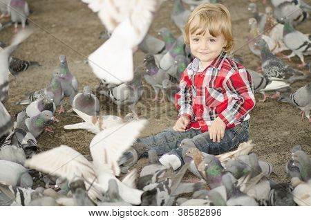 A Baby Smiling Surrounded by Doves Flying Around poster