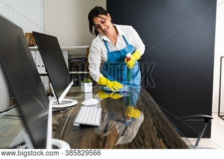 Janitor Cleaning Office Desk. Hygiene Cleaner Service