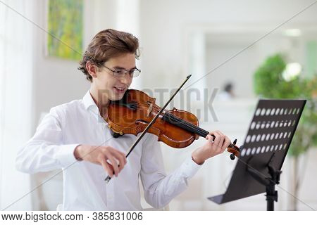 Man Playing Violin. Classical Music Instrument. Teenage Boy Practicing Viola. Teenager Art School St