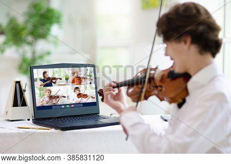 Violin Lesson Online. Teacher And Child Play Violin Via Computer. Remote Learning From Home.