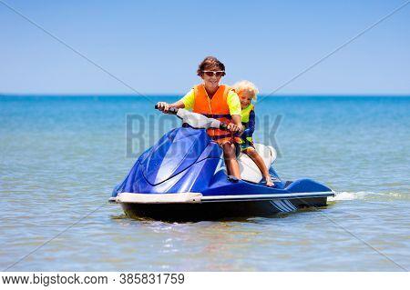 Family On Jet Ski. Water Sports For Kids.