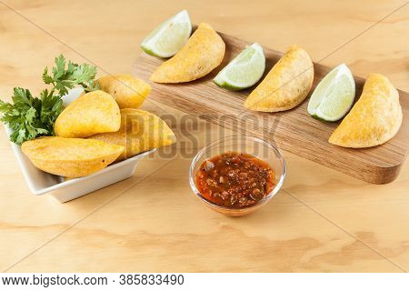Tasty Colombian Food, Fried Empanada; Photo On Wooden Background.