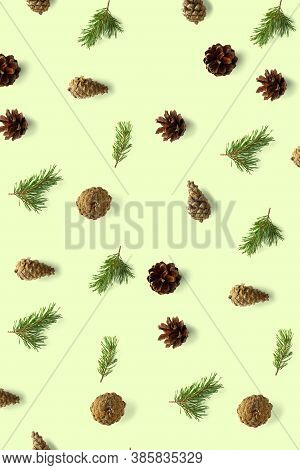 Pine Cone Christmas Background On Green. Pine Branches And Cones. Minimal Creative Cone Arrangement