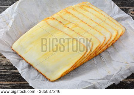 Stack Of Muenster Cheese Slices On White Paper Butcher Paper