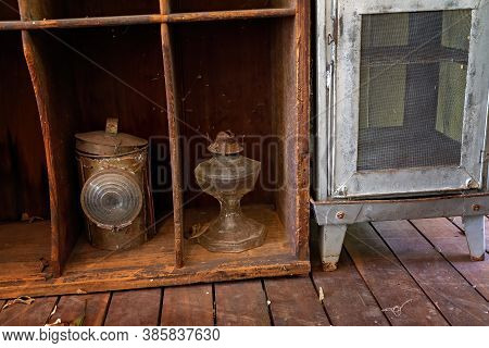 Decrepit Vintage Display Of Food Safe And Lanterns From Yesteryear