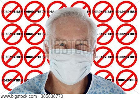 No Coronavirus. A Caucasian Man wears a Paper Face Mask to prevent contracting the Coronavirus AKA Covid-19 with an International No Coronavirus repeating logo behind him. Coronavirus is world wide.