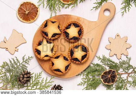 Christmas Homemade Mince Pies On Wooden Paddle Board On Pink Wooden Background