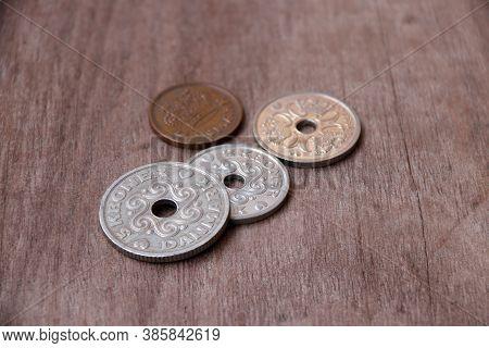 Coins Of Denmark On The Wooden Floor, Danish Krone Money, The Concept Of Finance.