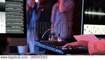 Close Up Of Asian Woman Hand Producer Working At Mixing Panel In The Boutique Recording Studio. Mode