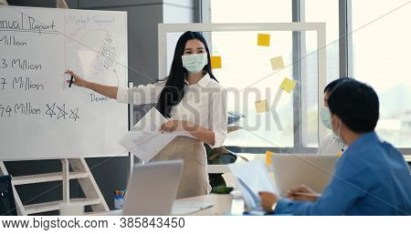 Asian Business Man In Medical Mask Hand Holding Note Paper Meeting With New Startup Project Share To