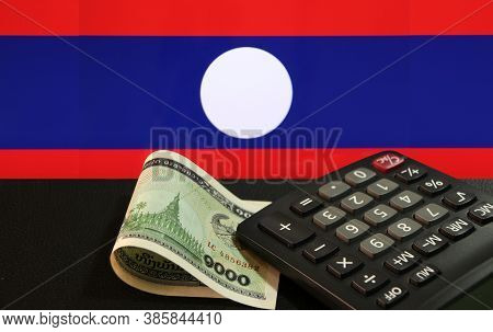 One Thousand Of Banknote Currency Lao Kip With Calculator On The Black Floor With Laos Nation Flag B