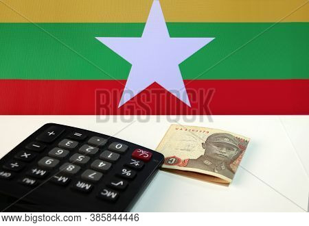 One Of Banknote Currency Myanmar Kyats With Calculator On The White Floor With The Union Of Myanmar