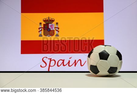 Small Football On The White Floor And Spanish Nation Flag With The Text Of Spain Background. The Con
