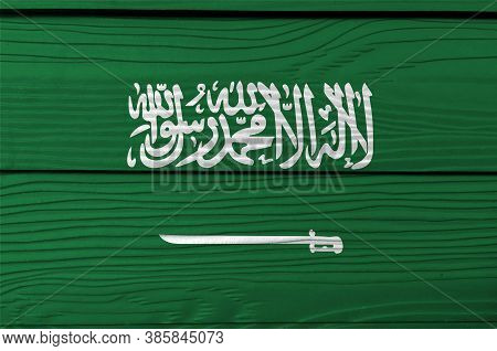 Flag Of Saudi Arabia On Wooden Wall Background. Grunge Saudi Arabia Flag Texture, A Green Field With
