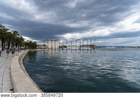 Splitska Riva Promenade With Palm Trees Between The Harbor And Diocletian S Palace In Split, Croatia
