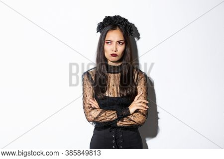 Image Of Mad Asian Woman In Gothic Lace Dress And Wreat, Cross Arms Chest, Frowning And Sulking Whil
