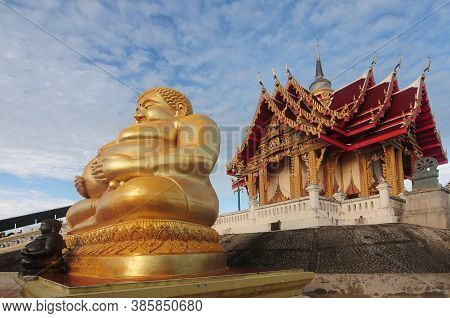 Golden Sitting Buddha Statue (katyayana) At Wat Pa Phu Hai Long In Nakhon Ratchasima Province, North
