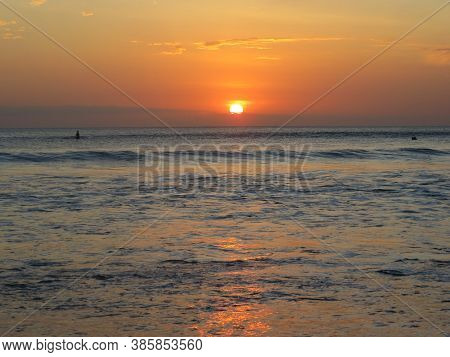 Kuta Beach Bali, One Of The Famous Place To See The Sunset.