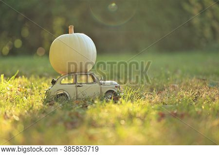 Thanksgiving Day. Halloween. Delivery Pumpkin Symbol. Autumn Season. Beige Decorative Car With A Whi