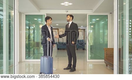 Smiling Asian Business Man People With Suitcase Luggage Walking To Hall Corridor And Talking To His