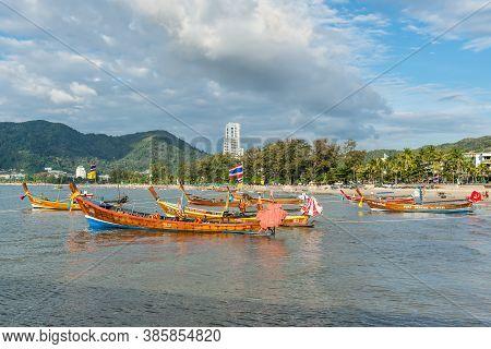 Phuket, Thailand - November 29, 2019: Traditional Longtail Boats Moored At Patong Beach In Phuket Is