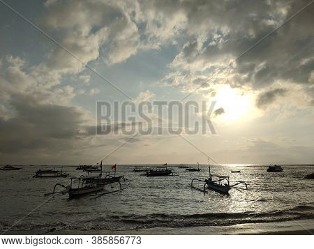 Denpasar, Indonesia - September 27, 2019: Silhouettes Of Jukung Boats On The Sea Of Sanur Beach.