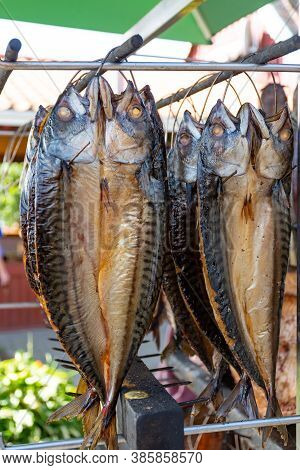 Dry Smoked Spiced Mackerel Fish In A Fish Market, Ready To Eat, Vertical