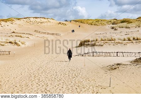 Tourists In Wonderful Nagliai Nature Reserve In Neringa, Lithuania. Dead Dunes, Sand Hills Built By