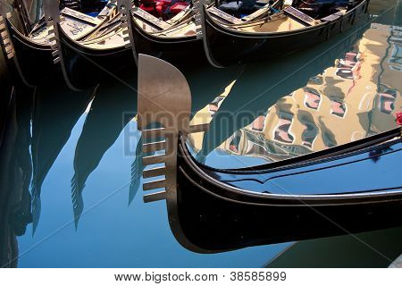Closeup of a gondola park in a canal, in Venice Italy