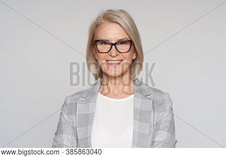Portrait Of Senior Woman In A Glasses And Jacket. Isolated