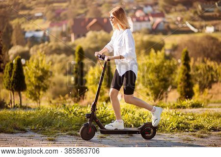 Young Beautiful Stylish Woman Riding Electric Scooter To Work, Modern Girl, Electric Transport, Ecol