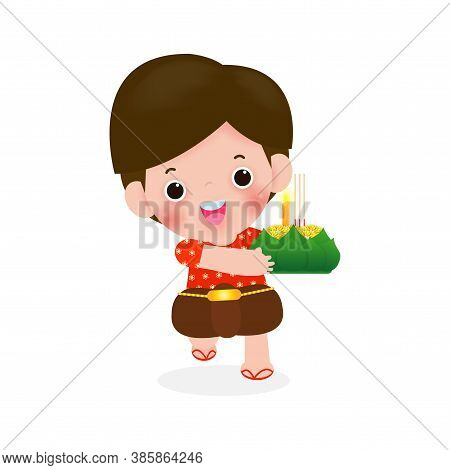 Loy Krathong Festival With Cute Little Boy In Thai National Costume Holding Krathong Isolated On Whi