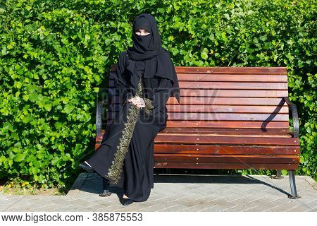 Arab Woman Migrant From The Middle East In Black National Clothes. Arab Woman Migrant From The Middl
