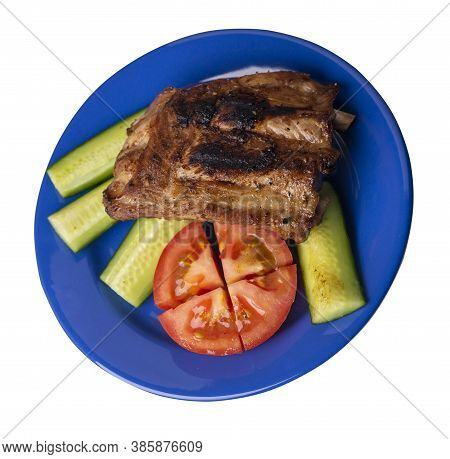 Grilled Pork Ribs With Sliced Cucumbers And Tomatoes On Blue Plate. Pork Ribs Isolated On White Back