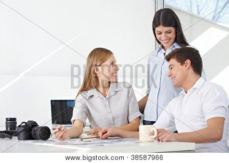 Photographer in photo agency doing image editing in the office