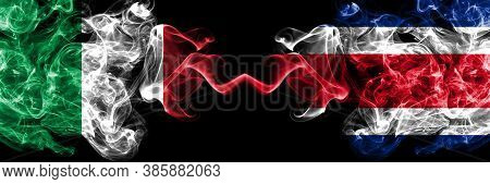 Italy Vs Costa Rica Smoky Mystic Flags Placed Side By Side. Thick Colored Silky Abstract Smoke Flags