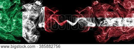 Italy Vs Latvia, Latvian Smoky Mystic Flags Placed Side By Side. Thick Colored Silky Abstract Smoke