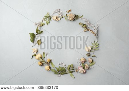 Dried Flowers And Leaves Arranged In Shape Of Wreath On Light Grey Background, Flat Lay With Space F
