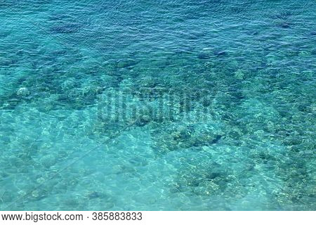 Azure Water Texture, Transparent Sea Surface With A Rocky Bottom. Aerial View, Natural Blue Backgrou