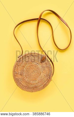 Fashionable Handmade Natural Round Rattan Bag On Yellow Background. Stylish Eco Bamboo Bag. Summer F
