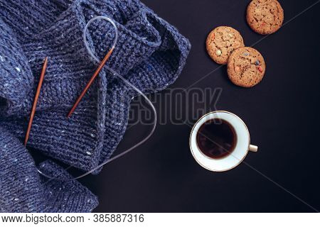 Blue Knit Sweater, Knitting Needles, Porcelain Gold Cup With Coffee And Flavored Cookies With Colore