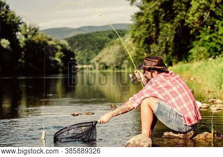 United With Nature. Fisherman Fishing Technique Use Rod. Man Catching Fish. Guy Fly Fishing. Success