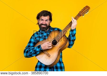Music And Vocal. Playing The Guitar On Party. Old Fashioned Bearded Hipster Play String Instrument.