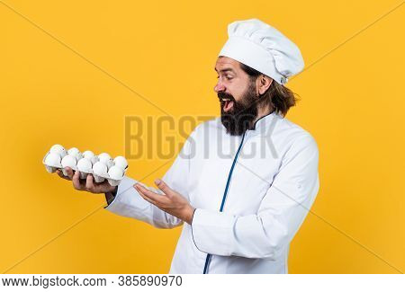 How To Cook Eggs. Concept Of Housekeeping. Mature Bearded Man Wear Chef Hat. Male Cook Ready For Pre