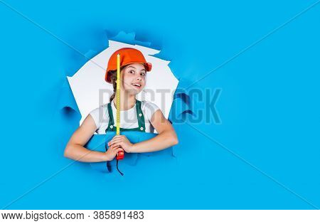 Happy Child Hold Tape Measure. Kid Builder Wear Helmet. Teen Girl In Hard Hat And Uniform. Building