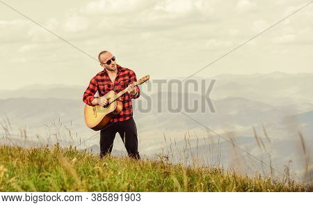 Your Number One Rock Station. Acoustic Guitar Player. Country Music Song. Sexy Man With Guitar. Hips