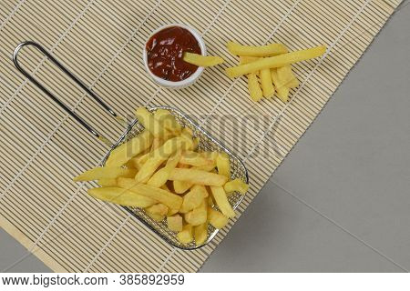 Portion Of Potato Chips In A Metal Basket