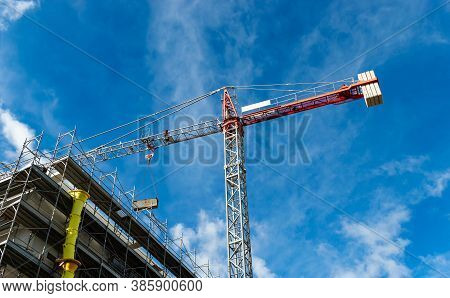 Red Tower Crane Building Against A Blue Sky With Clouds. Building Crane Build Apartment, Build House